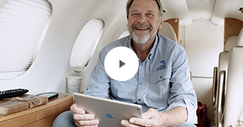 Rick Lindsey using inflight wifi on his business aircraft