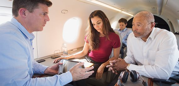 corporate passengers connecting to wifi on a private jet