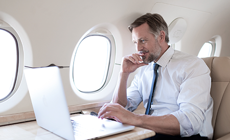 a businessman surfing the web on a bombardier challenger