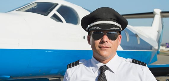 a pilot standing in front of his light jet